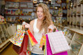 Happy young woman with shopping bags Stock Photography