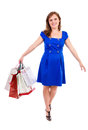 Happy young woman with shopping bags against white background Stock Photo
