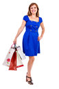 Happy young woman with shopping bags against white background Royalty Free Stock Photo