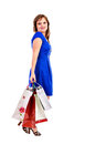 Happy young woman with shopping bags against white background Royalty Free Stock Photography