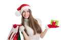 Happy young woman with shopping bags and gift box cute caucasian brunette teenage girl wearing santa hat gloves isolated on white Stock Photography