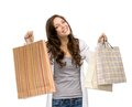 Happy young woman with shopping bags half length portrait of isolated on white concept of consumerism and purchase Stock Images