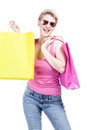 Happy young woman with shopping bags isolated on white Royalty Free Stock Image