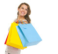 Happy young woman with shopping bags looking on copy space portrait of Stock Photos