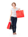 Happy young woman with shopping bags white over white background full portrait Stock Photography