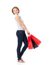 Happy young woman with shopping bags white over white background full portrait Stock Photos