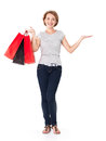 Happy young woman with shopping bags white over white background full portrait Stock Images
