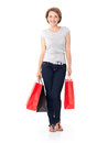 Happy young woman with shopping bags white over white background full portrait Stock Photo