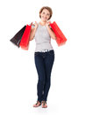 Happy young woman with shopping bags white over white background full portrait Stock Image