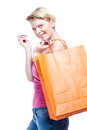 Happy young woman shopping isolated on white Royalty Free Stock Photos