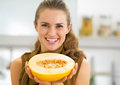 Happy young woman showing melon slice Royalty Free Stock Photo
