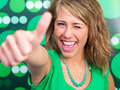 Happy young woman showing thumb's up sign Royalty Free Stock Photos