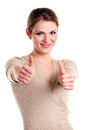Happy young woman showing thumb up sign