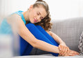 Happy young woman sitting on couch in living room modern Royalty Free Stock Photography