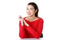 Happy young woman sitting at the desk Royalty Free Stock Photo
