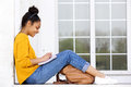 Happy young woman sitting outdoors writing a book Royalty Free Stock Photo