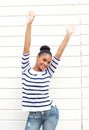 Happy young woman smiling with arms raised portrait of a Royalty Free Stock Images