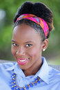 Happy young woman smiling stock image of a jamaican Royalty Free Stock Images