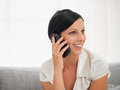 Happy young woman speaking mobile phone Royalty Free Stock Photography