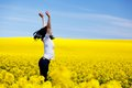 Happy young woman on spring field. Success Royalty Free Stock Photo