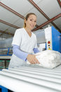 Happy young woman standing at dry cleaners Royalty Free Stock Photo