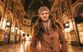 Happy young woman standing in Galleria Vittorio Emanuele II Royalty Free Stock Photo