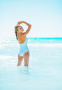 Happy young woman standing in sea Royalty Free Stock Photo