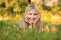 Happy young woman on a summer flower meadow outdoor Royalty Free Stock Photo