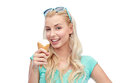 Happy young woman in sunglasses eating ice cream Royalty Free Stock Photo