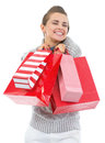 Happy young woman in sweater with christmas shopping bags isolated on white Stock Photos