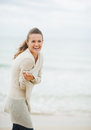 Happy young woman in sweater on coldly beach with long hair Royalty Free Stock Photo