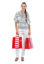 Happy young woman in sweater holding christmas shopping bags full length portrait of isolated on white Royalty Free Stock Photo
