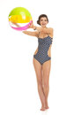 Happy young woman in swimsuit with beach Royalty Free Stock Photo