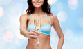 Happy young woman in swimsuit drinking champagne Royalty Free Stock Photo