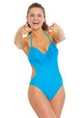 Happy young woman in swimsuit pointing in camera isolated on white Stock Photos