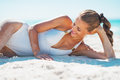 Happy young woman in swimsuit relaxing on beach white sandy Royalty Free Stock Images