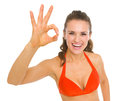 Happy young woman swimsuit showing ok gesture isolated white Royalty Free Stock Photo