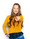 Happy young woman or teen pointing finger on you Royalty Free Stock Photo