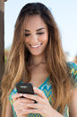 Happy young woman texting close up of a writing a message with your phone Royalty Free Stock Photography