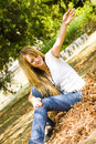 Happy young woman throwing leaves Stock Photography