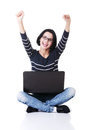 Happy young woman using her laptop Stock Photo