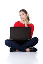 Happy young woman using her laptop Stock Image