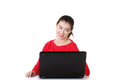 Happy young woman using her laptop. Royalty Free Stock Photos