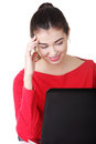 Happy young woman using her laptop. Stock Photo