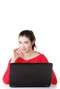 Happy young woman using her laptop. Stock Photos