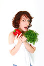 Happy young woman with vegetables Royalty Free Stock Photos