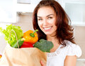 Happy young woman with vegetables in shopping bag diet concept Royalty Free Stock Images