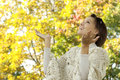 Happy young woman walking in the forest fall Royalty Free Stock Photos