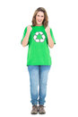 Happy young woman wearing green shirt with recycling symbol on white background Stock Photo