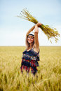 Happy young woman in wheat field Royalty Free Stock Photo